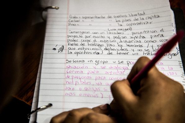 "2015, Buenos Aires, Argentina. One of the students takes notes during a lecture with the topic of human rights and imprisionment prepared by her teacher and members of an organization called ""Sueños de Libertad"" (dreams of freedom)."